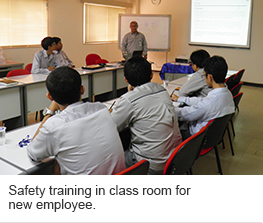 Safety training in class room for new employee.